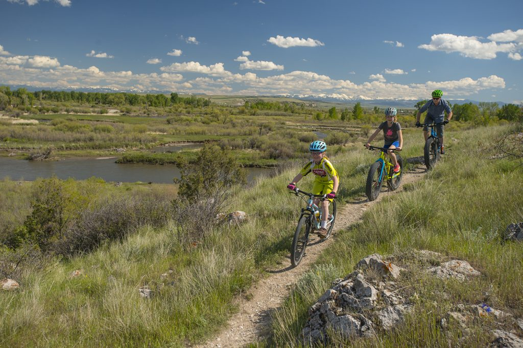 A father and daughter ride mountain bikes at Headwaters State Park near Three Forks, MT.