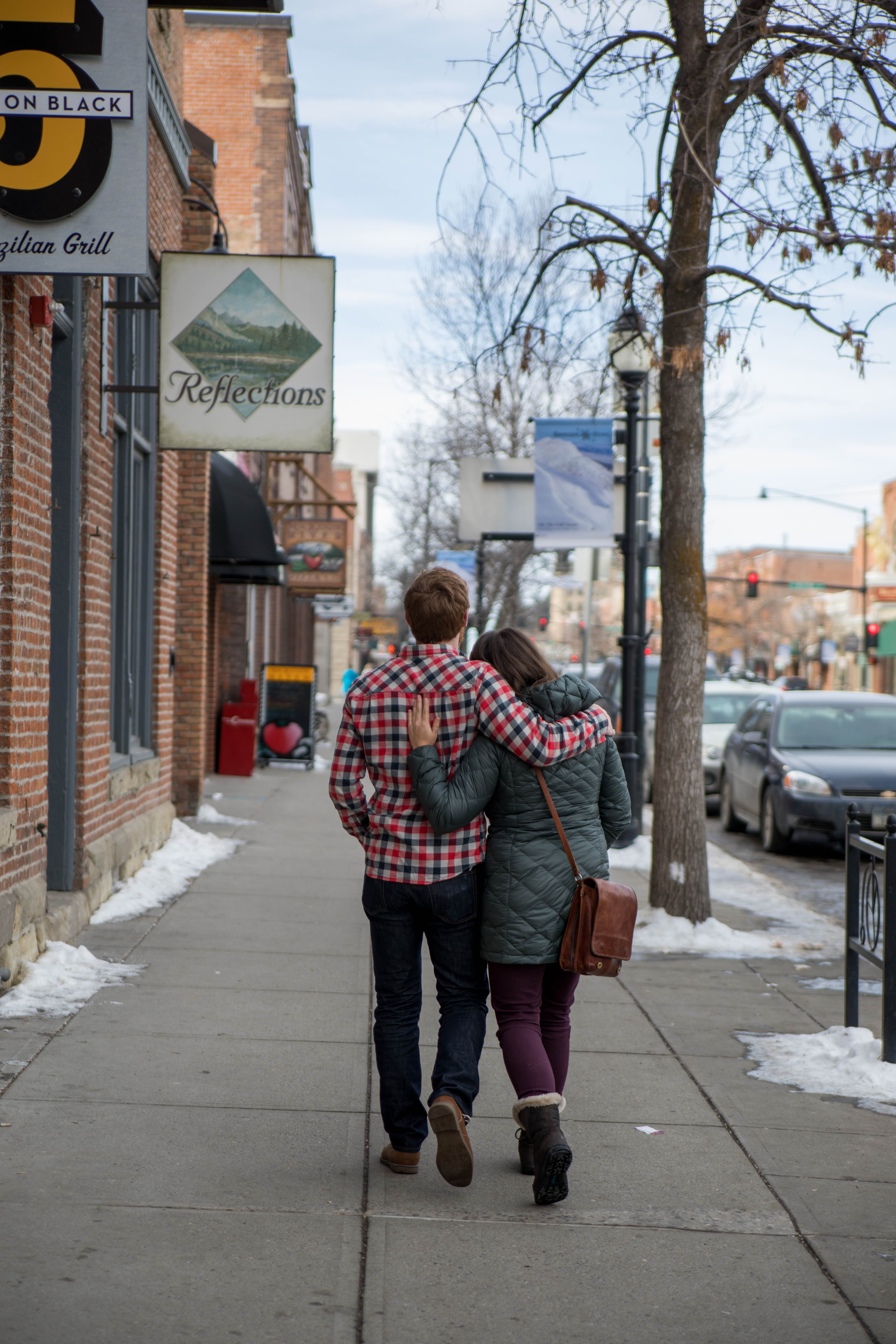 A couple strolls in Downtown Bozeman located in Montana's Yellowstone Country