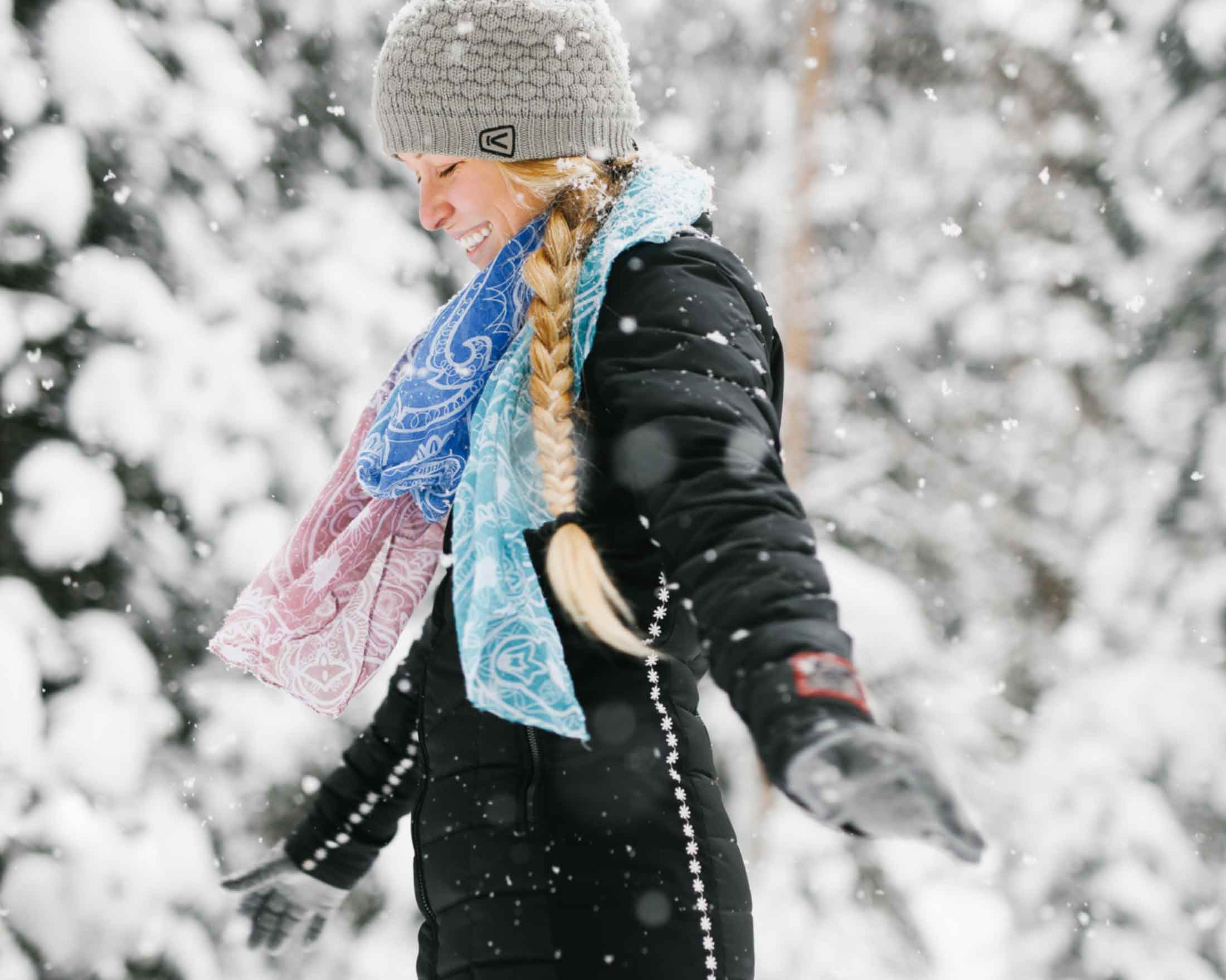 Woman enjoys the falling snow in Yellowstone Country Montana