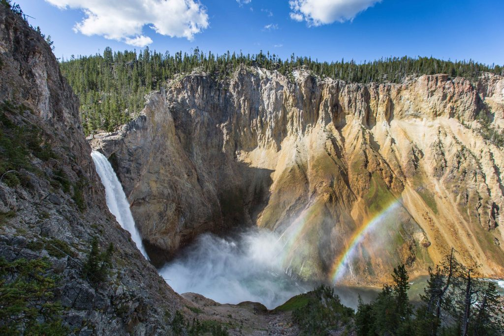 A double rainbow sits over the lower falls of the Yellowstone River in Yellowstone National Park